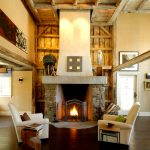 two floor stone and log house  wood floor sofa fireplace door logs painting stones pillows ceiling