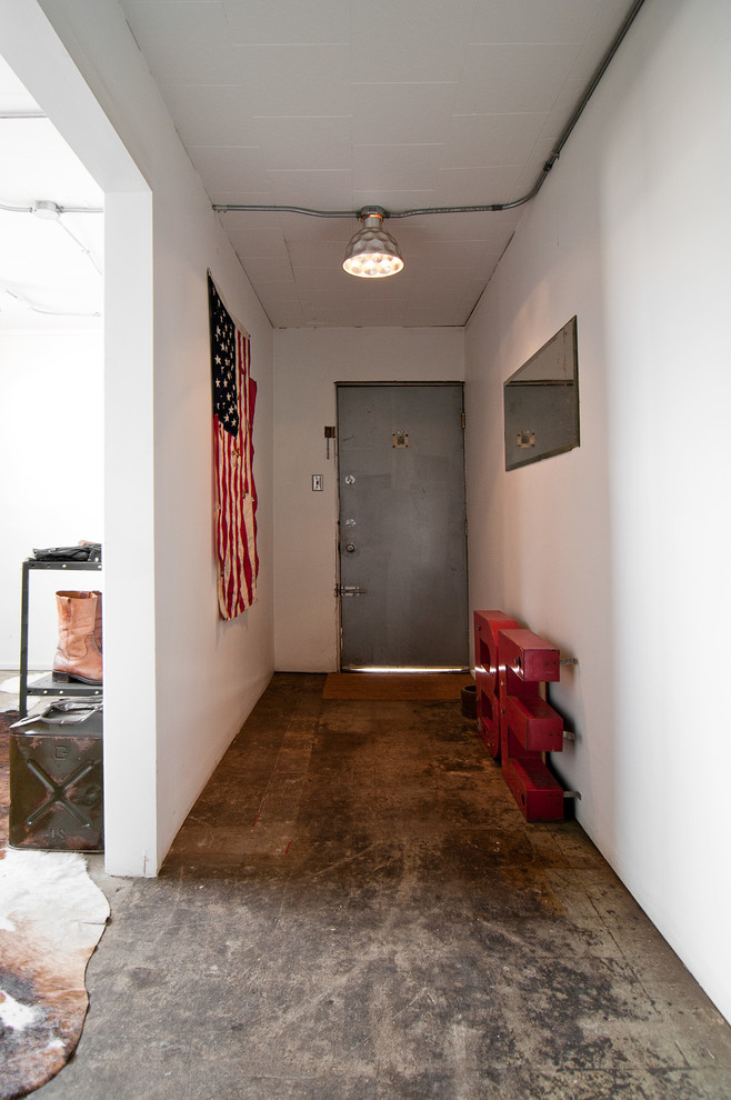 unique steel doors concrete floor lamp carpet entryway flag industrial style white wall boots interesting lighting