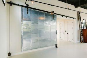 unique steel doors numbers mirror lamps lightig door handles small wheels while floor wall metal door