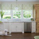 Vintage Kitchen With Green Half Window Curtains White Kitchen Counter White Cabinetry Wooden Storage Dark Wood Floors