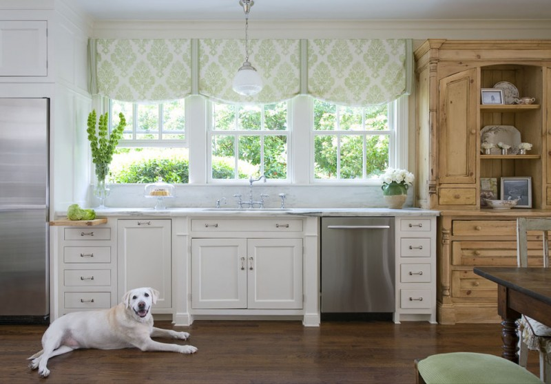 vintage kitchen with green half window curtains white kitchen counter white cabinetry wooden storage dark wood floors