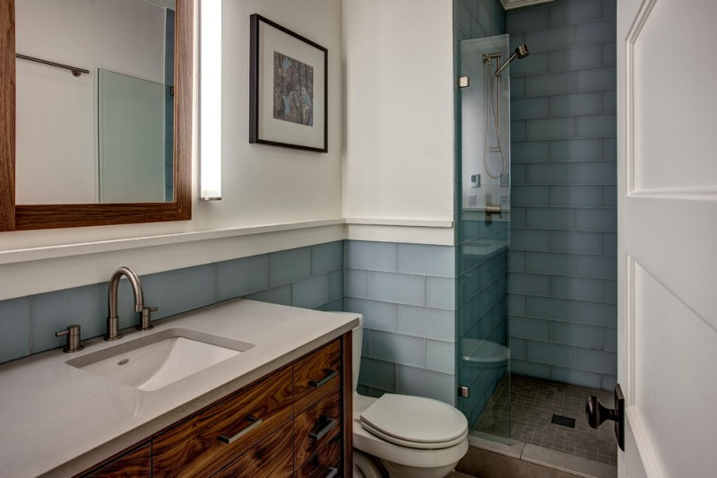 Walk In Bathroom Design With Blue Glass Tiles Walls And Dark Beige Tiles  Floors White Countertop