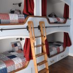 white bunk beds with room, storage under, slidin brown wooden rail