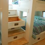 white bunk beds with stairs for storage