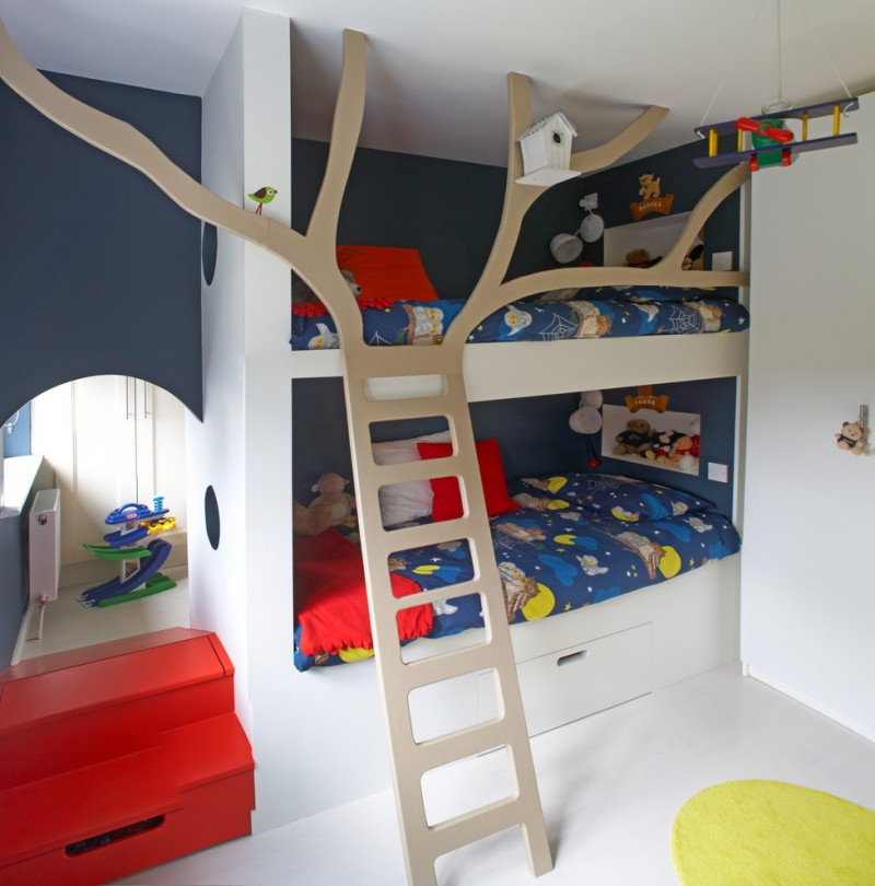white bunk beds with storage under, brown wooden stairs shaped like branch for rails
