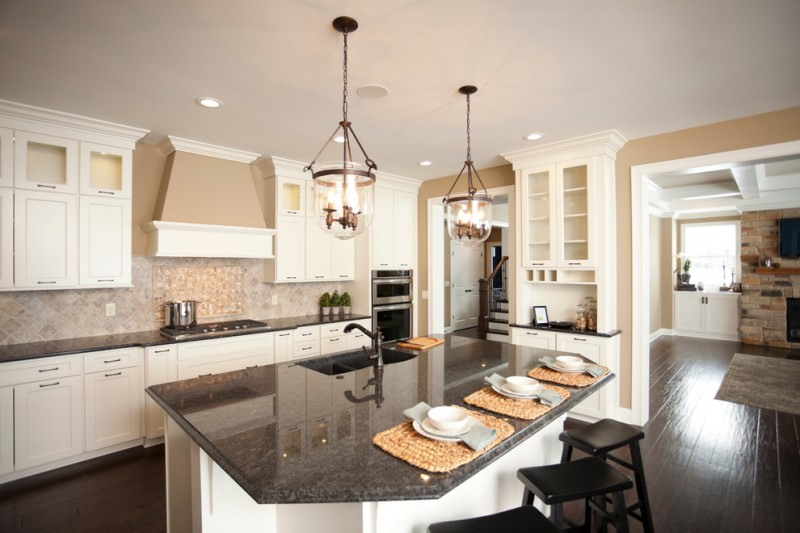 Relishing cooking at kitchen with white cabinet and - Black granite countertops with cream cabinets ...