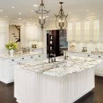 white cabinet granite countertop double islands ceiling lights glass cabinet wine storage dark hardwood floor