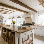 White Cabinet Pendant Lights Brick Backsplash Wooden Beams Wooden Stools Wooden Topped Table Open Shelves