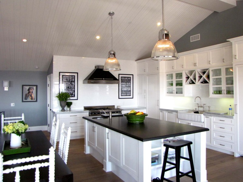 white cabinet white wine storage marble counter top grey wall dark dining table dark wooden stool