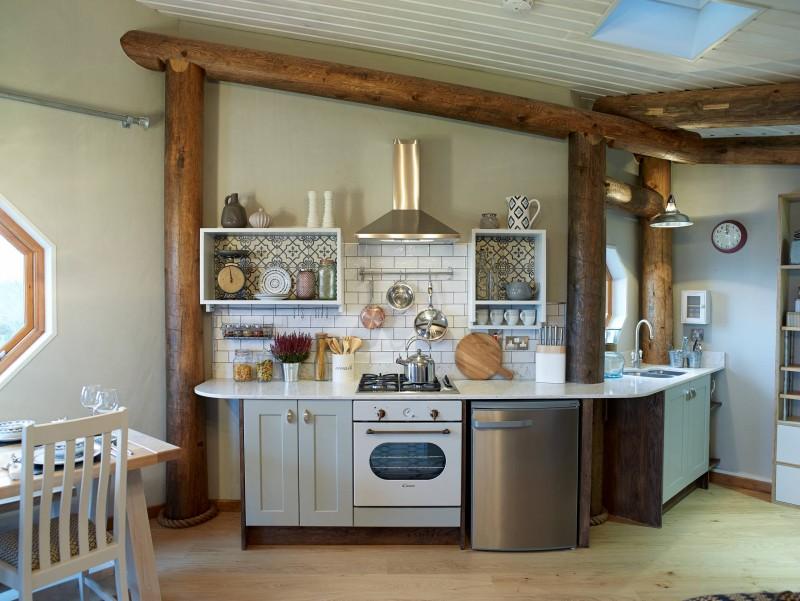 white counter top white tiled backsplash open floating shelves big wood golden hood