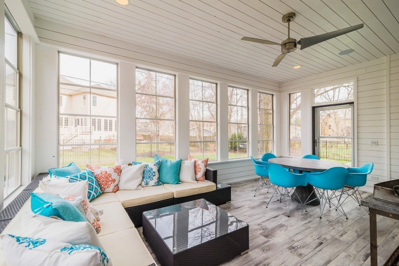 white horizontal wood paneling in sunroom