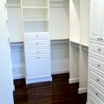 White Melamine Walk In Closet Organizer Consisting Adjustable Shelves Double Hanging Sections Drawer System Dark Wood Flooring System