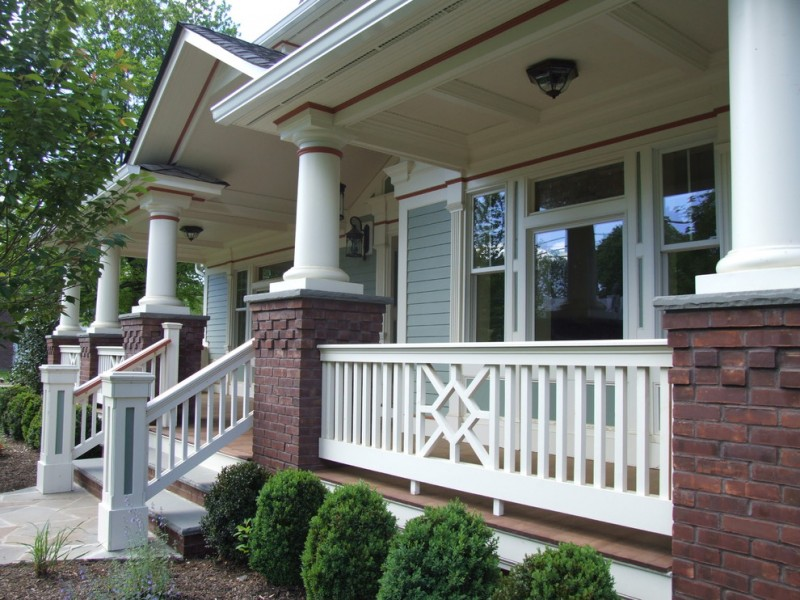 white railings idea made of wooden traditional exterior home with light grey siding dark red bricks pillars' base