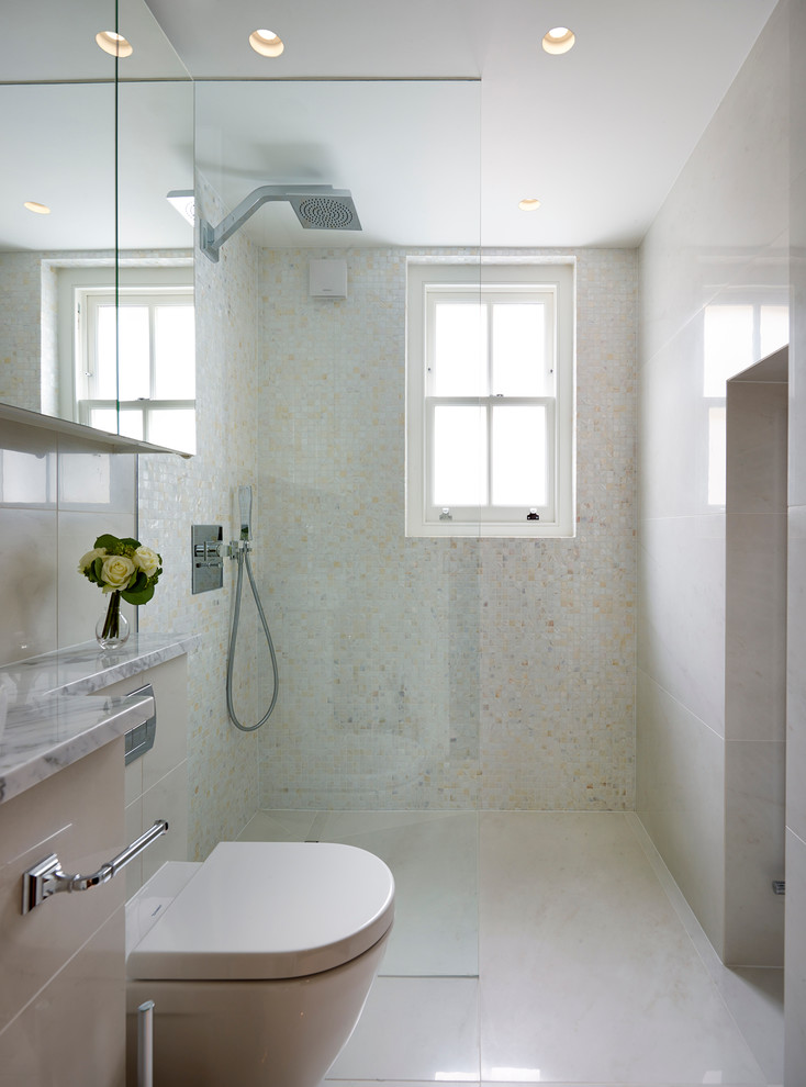 white small bathroom with white ceiling, flooring, walls, white toilet, white cabinet, glass partition, glass window