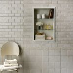 White Tiles Bathroom With Little White & Textured Decoration Recessed Shelves For Storing Bath Properties White Chair A Pile Of White Towels