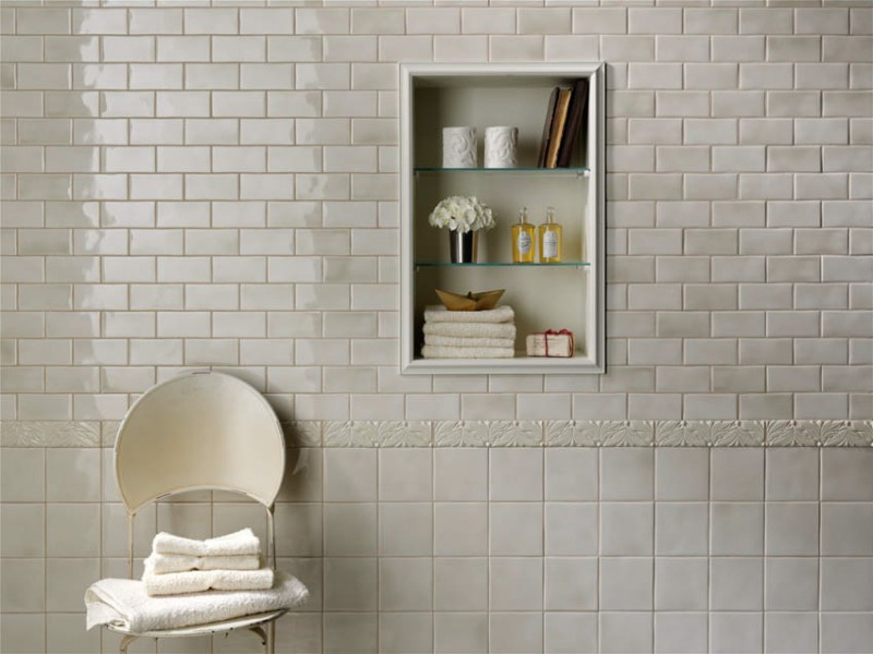 white tiles bathroom with little  textured decoration recessed shelves for storing bath properties The Options of Simple Chic Tiled Bathroom Floors and Walls Decohoms