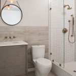 White Tiles For Shower Walls White Tiles For Shower Floors White Marble For Vanity's Walls And Floors A White Toilet Floating Pale Wooden Vanity Single Vessel Sink Rounded Mirror With Decorative Rope