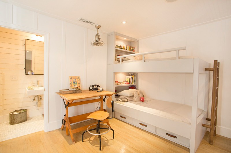 white wooden bunk beds with strorage under and shelves on both headboard, brown wooden stairs
