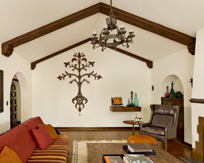 wood beams ceiling lamp decorated wall orange stripped sofa brown couch wooden floor wooden table