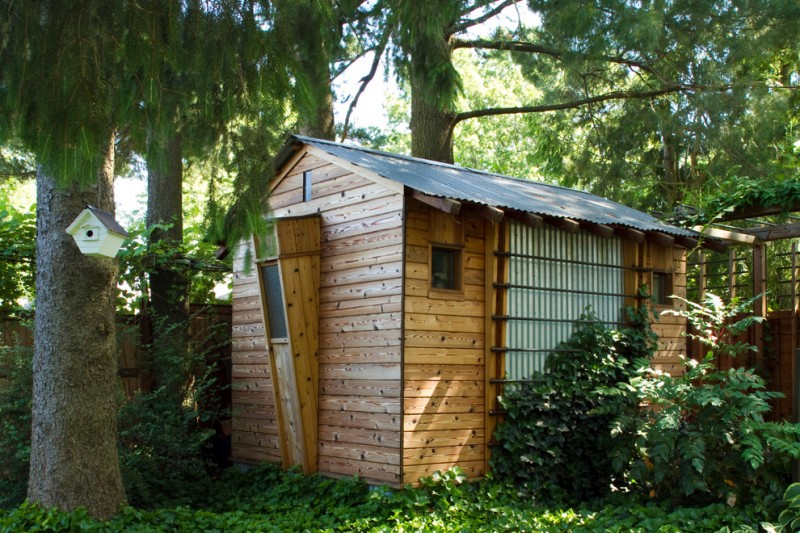 wooden gardening shed with lightweight metal roofs