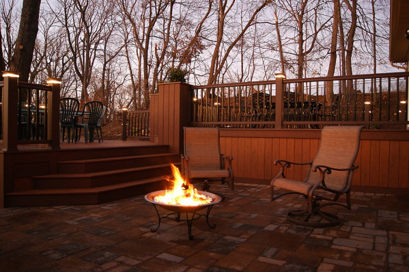 Multilevel PVC deck building with solid skirting idea dark wood railing system for deck rustic style patio furniture