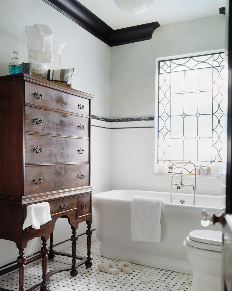 Victorian bathroom design with white bathtub antique wood storage traditional floors white walls