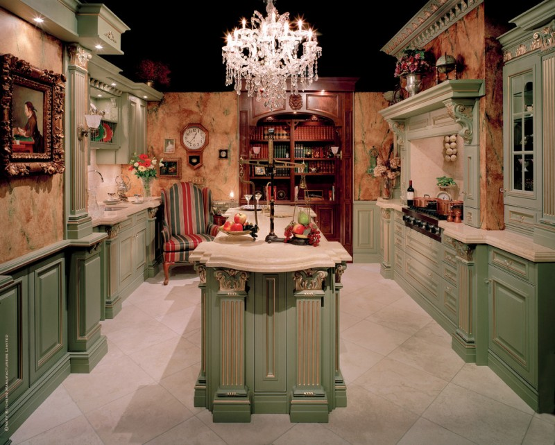 Victorian kitchen with green island with white top, green cabinet with white top, green wall mounted cabinet, white backsplash, brown orange marble wall, brown wooden shelves, chandelier