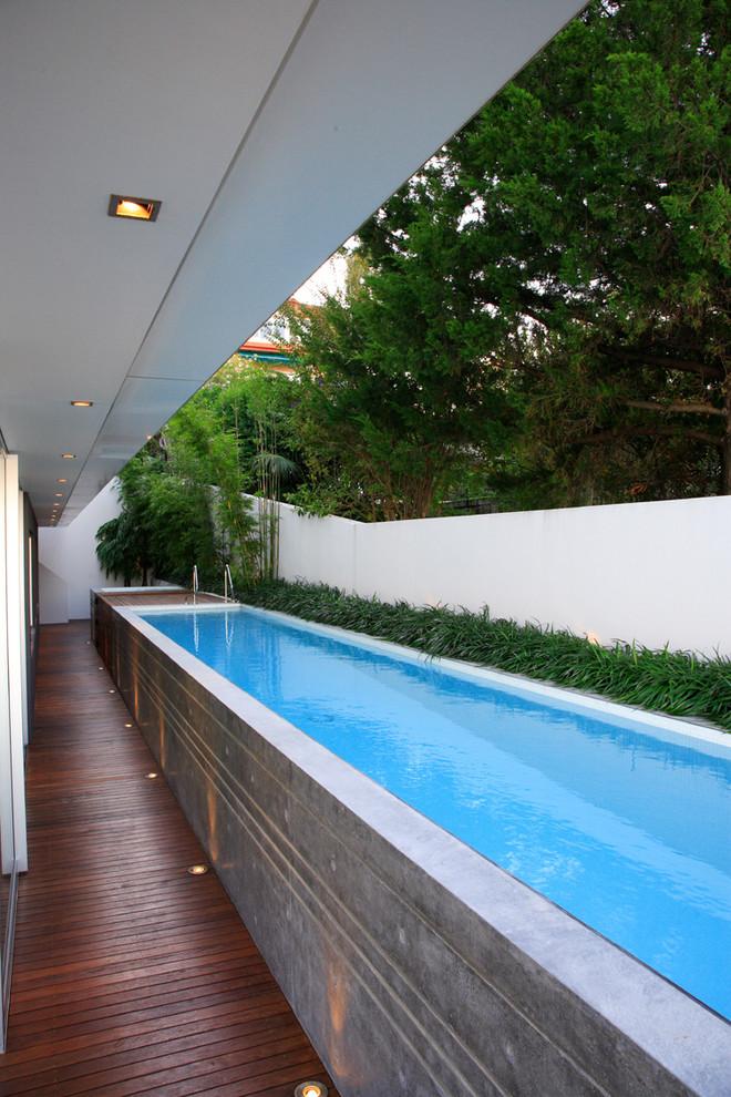 above ground lap swimmingpool bamboo deck bamboos green bushes
