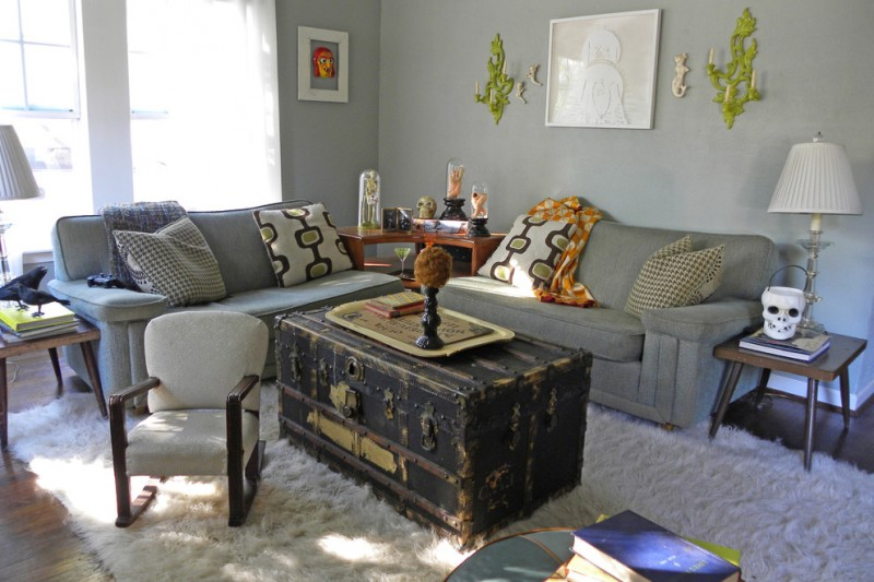 antique trunk coffee table gray walls and dark hardwood floors quality furniture and persian rugs living room sofas