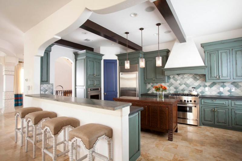 arabeaque backplash kitchen wall cabinets ceiling hanging lamps stools flowers mediterranean room