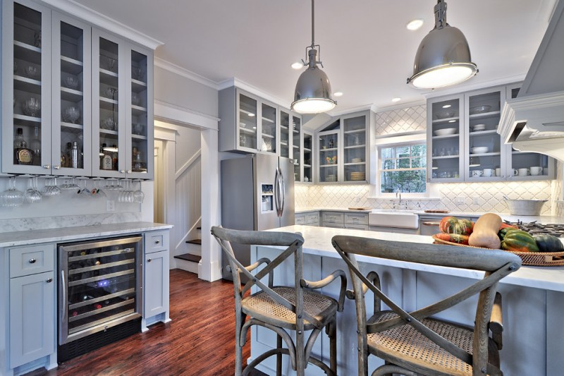 arabeaque backsplash kitchen hardwood floor wall cabinets window chairs traditional room pendant lights ceiling lamps