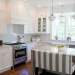 arabeaque backsplash kitchen wall cabinets ceiling lights hardwood floor window traditional room stove hanging lamps sink