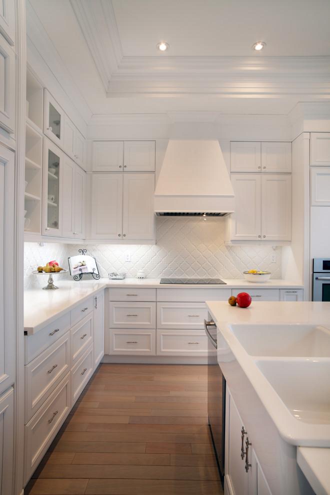 arabeaque backsplash kitchen wood floor wall cabinets ceiling lights traditional room