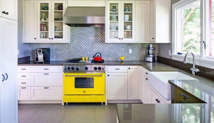 arabesque backsplash kitchen big windows yellow pop stove wall cabinets faucet sink traditional room