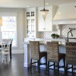 arabesque backsplash kitchen dark floor dining chairs table hanging lights windows traditional room wall cabinets