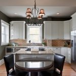 arabesque backsplash kitchen dining chairs contemporary room wall cabinets chandelier windows table ceiling lights
