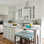 arabesque backsplash kitchen hardwood floor pendant lights stools wall cabinets flowers transitional room ceiling lamps
