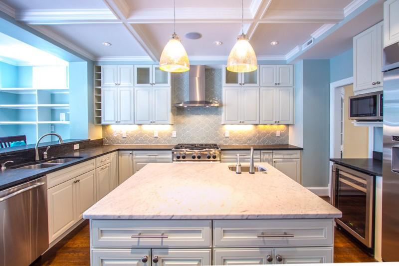 arabesque backsplash kitchen hardwood floor wall cabinets shelves faucet sink beautiful pendant lights ceiling lamps