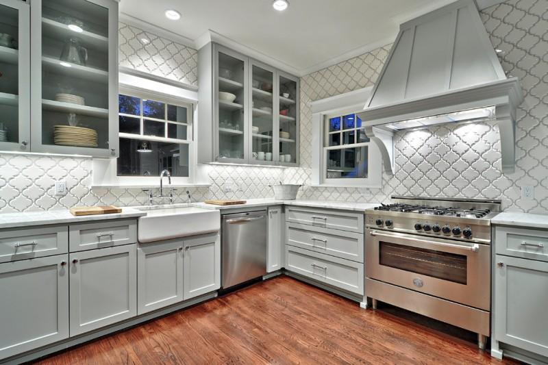 arabesque backsplash kitchen wall cabinets with glass doors windows faucet sink hardwood floor stove traditional room
