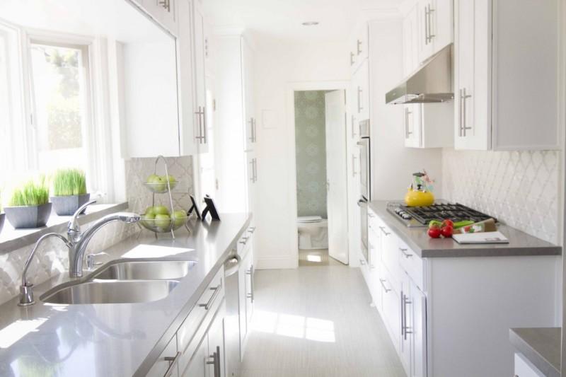 arabesque backsplash kitchen window decorative plants wall cabinets narrow room contemporary style faucet sink