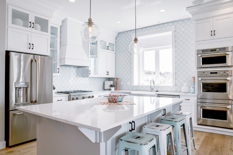 arabesque backsplash kitchen wood floor big window old looking stools wall cabinets transitional room hanging lamps