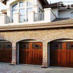 arched window garage wooden garage glass window brick wall three car garage