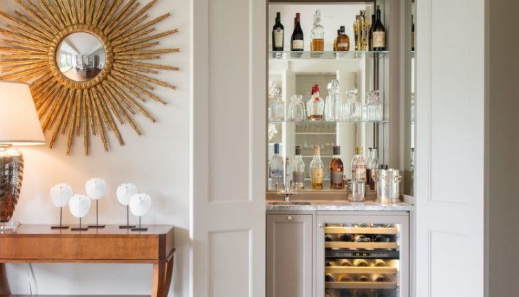 bar cupboard withbottle shelves, marble counter top with sink