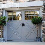 barn style garage glass window garage white garage window shutter brick wall outdoor lights