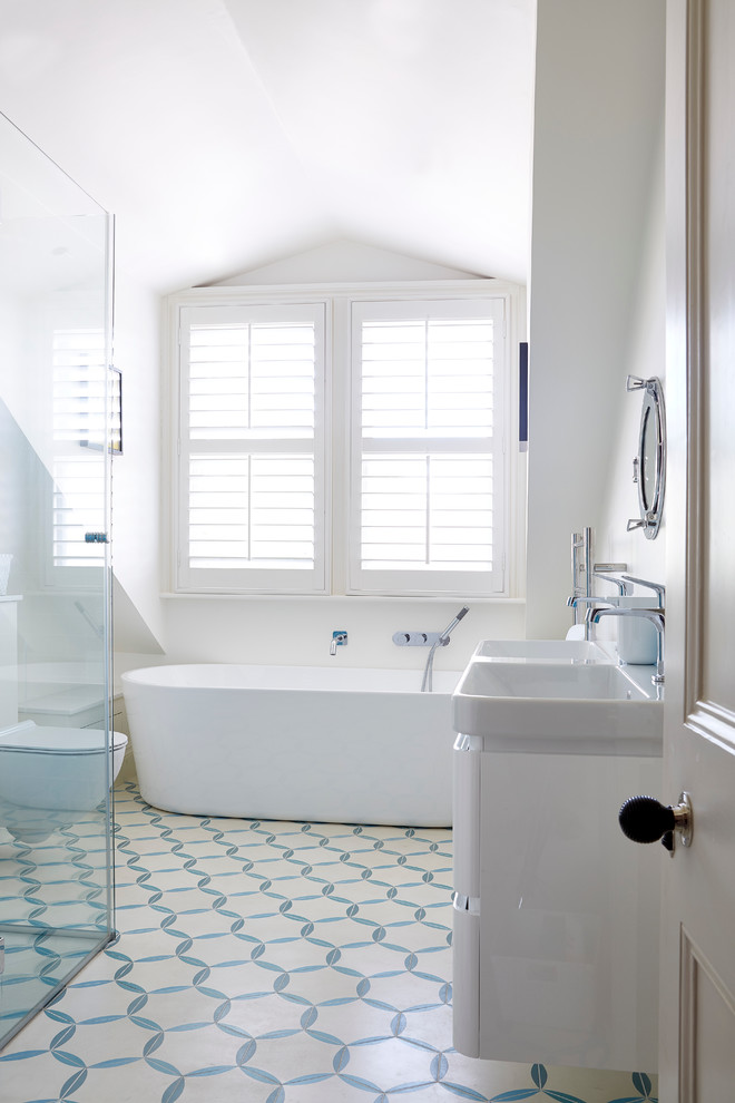 bathroom with white blue tiles flooring