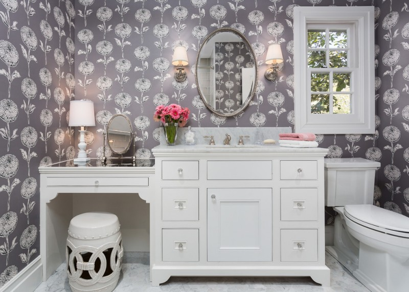 bathroom with white cabinet, white countertop vanities with sink, round mirror, sconces, shorter area for makeup area, with round makeup mirror, white ottoman
