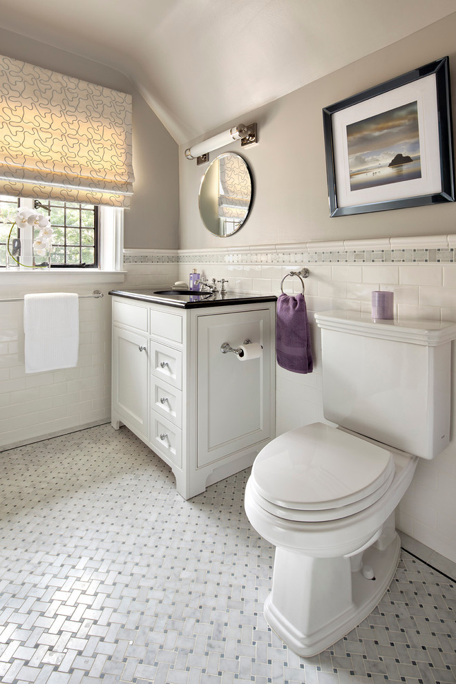 bathroom with white subway tiles