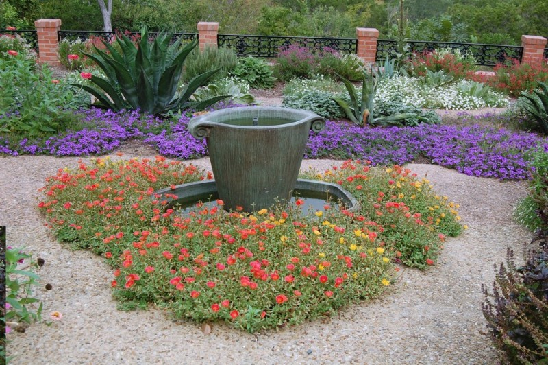 beautiful home gardens with fountains purple flowers railing red flower plants grass fountain traditional landscape