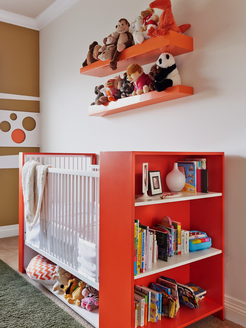 bed with bookshelf against and toyshelf under in gender neutral nursery