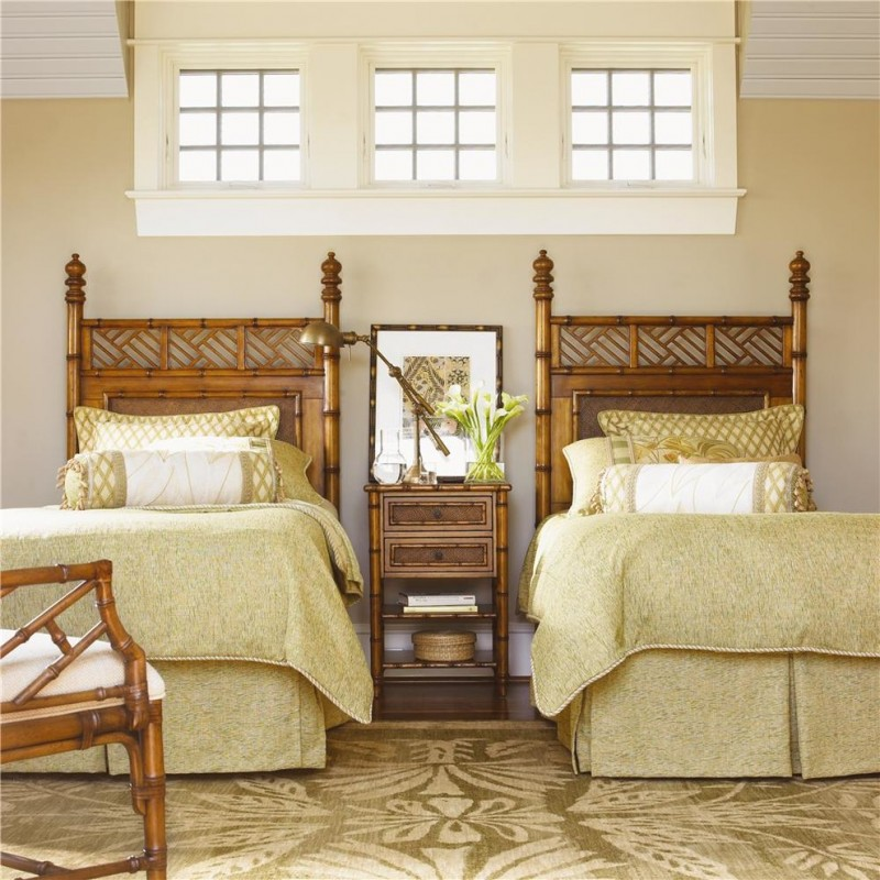 bedroom with cream wall, white ceiling, brown flooring, twin bamboo headboard beds, bamboo side table, white wooden framed window